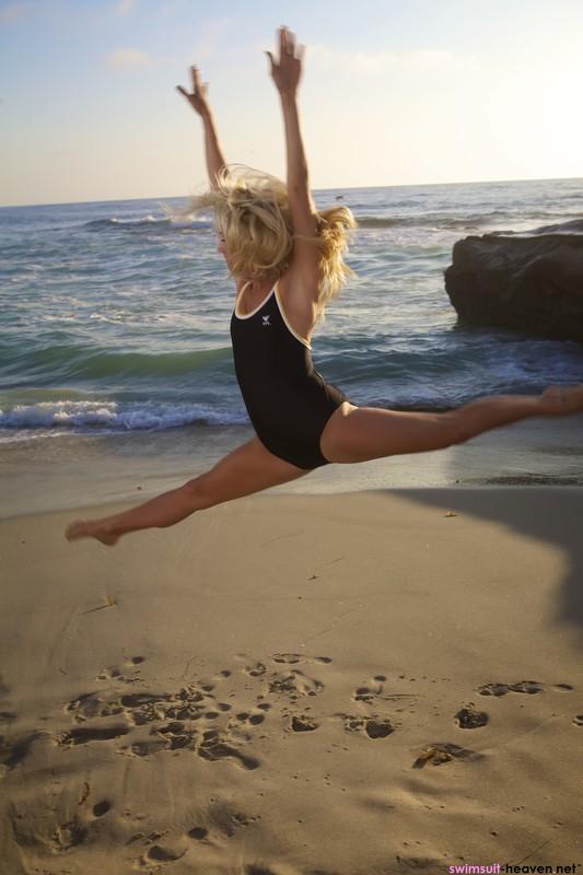 blonde beach girl Amanda in sexy black tyr swimsuit