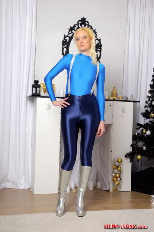 blonde female Yana U in blue denim pants