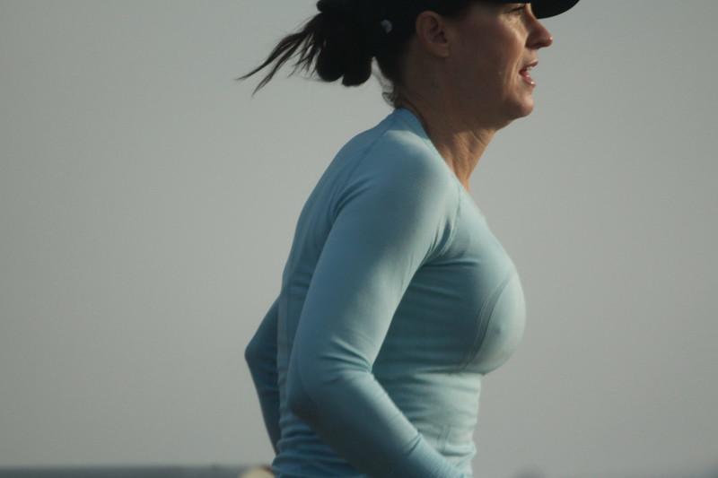 lovely jogger milf in blue yoga pants