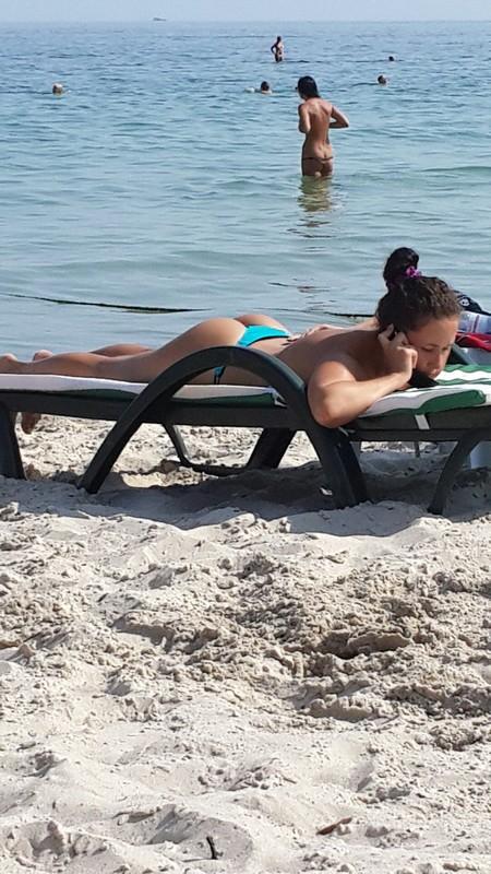 pretty beach chick in green bikini thong