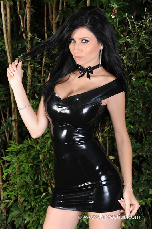 lustful female Anastacia in latex dress & latex boots