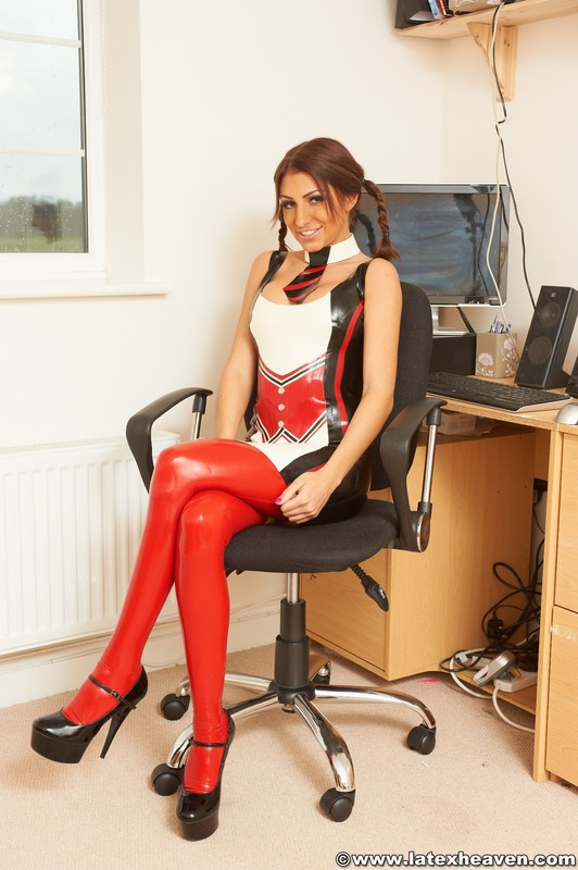 hot secretary girl Jenny in shiny latex uniform