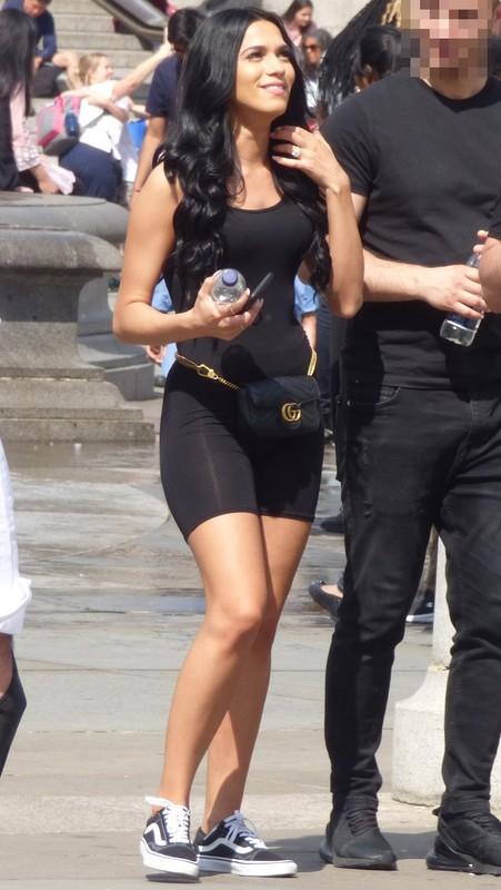 hot brunette female in spandex shorts