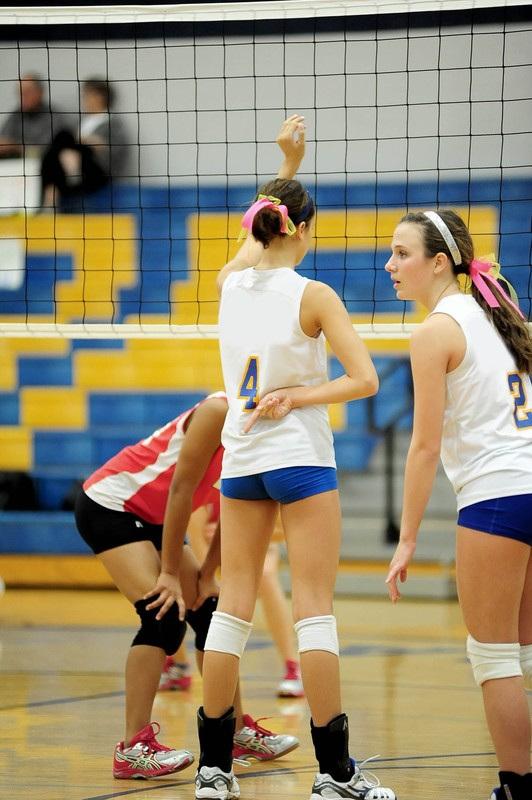 college volleyball girl in blue spandex shorts