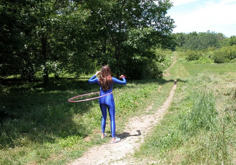 hula hoop babe Lexi in blue adidas catsuit