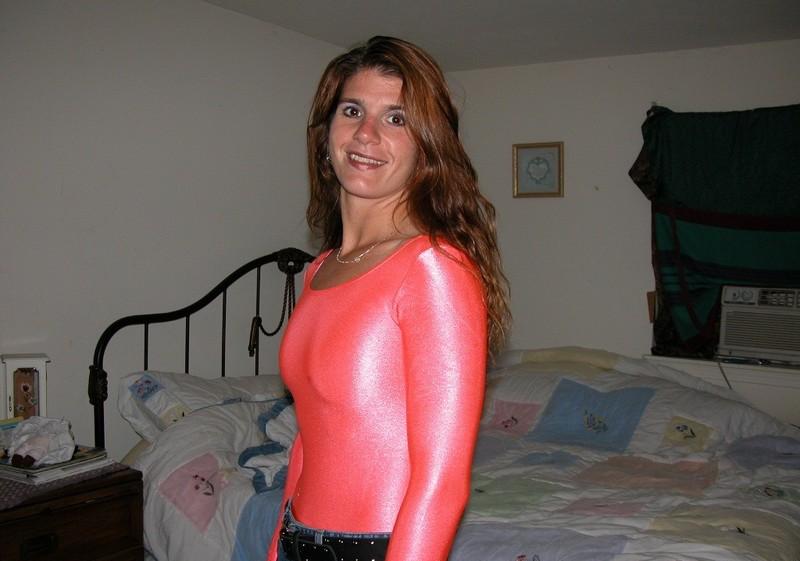 handsome milf Dee in pink lycra bodysuit