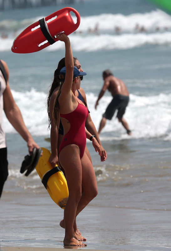pretty lifeguard girl in red 1 piece swimsuit