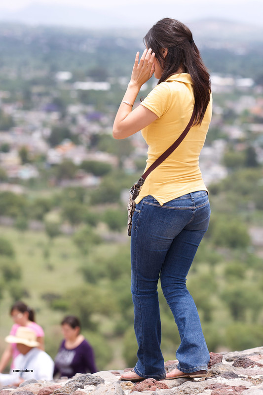 tourist lady in candid denim pants