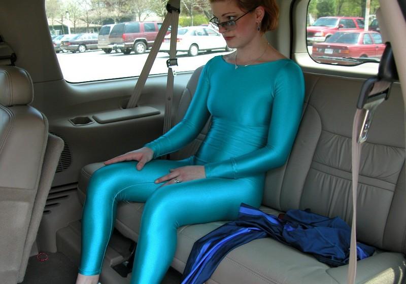 naughty lady Estelle in cyan catsuit