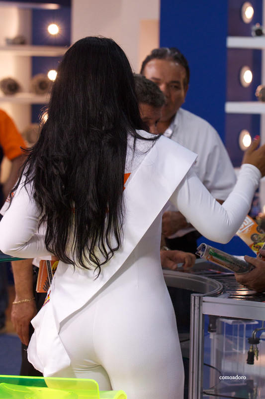 hot promo lady in white catsuit