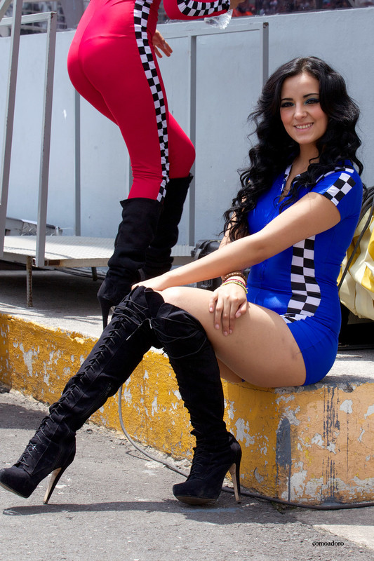 latina race queen in boots & blue spandex outfit