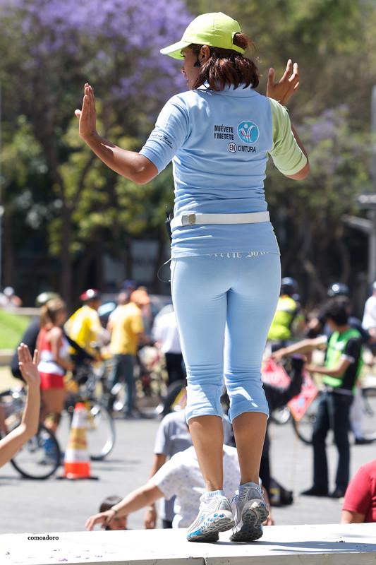 beautiful gym coach lady in blue yoga pants