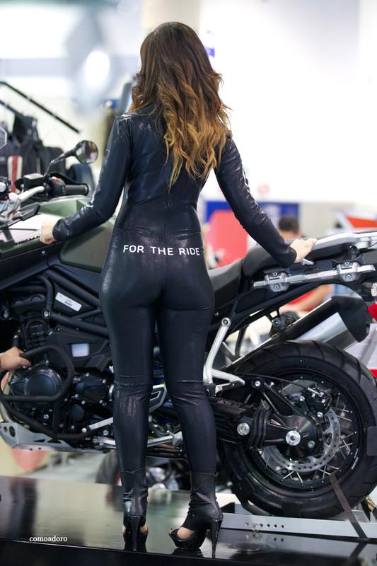 bike show promo girls in shiny catsuits