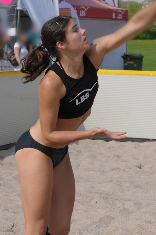 sexy beach volleyball girls in candid bikini