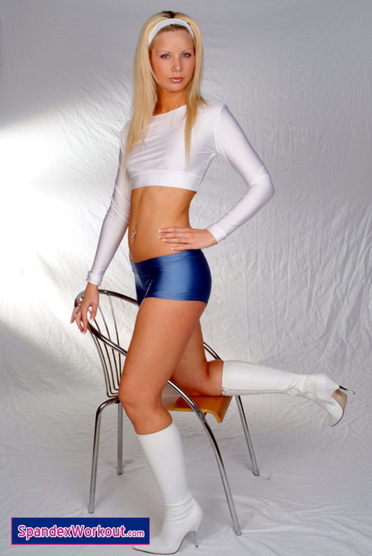 chamring blonde teen in blue hotpants and white top