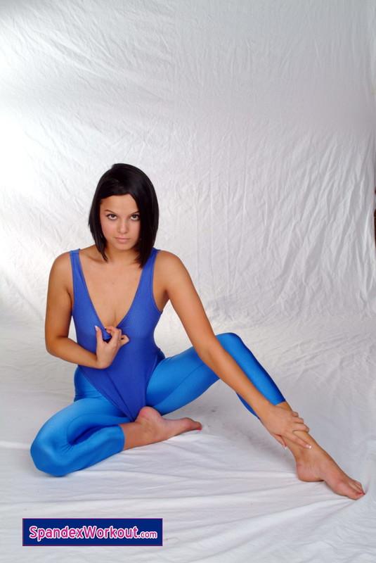 brunette girl in blue leotard & leggings