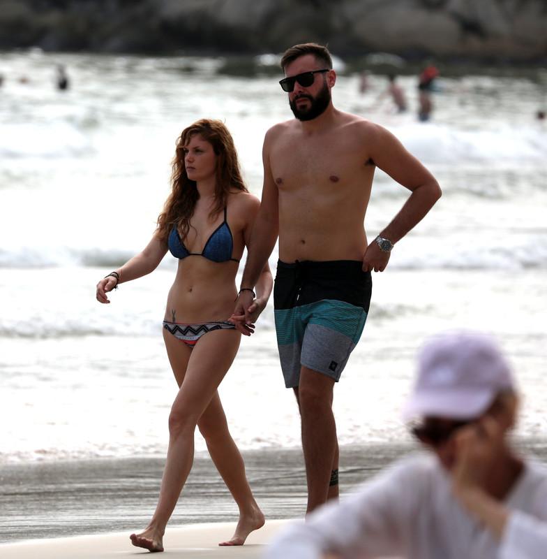 pretty wife with a playboy tattoo showing her new bikini