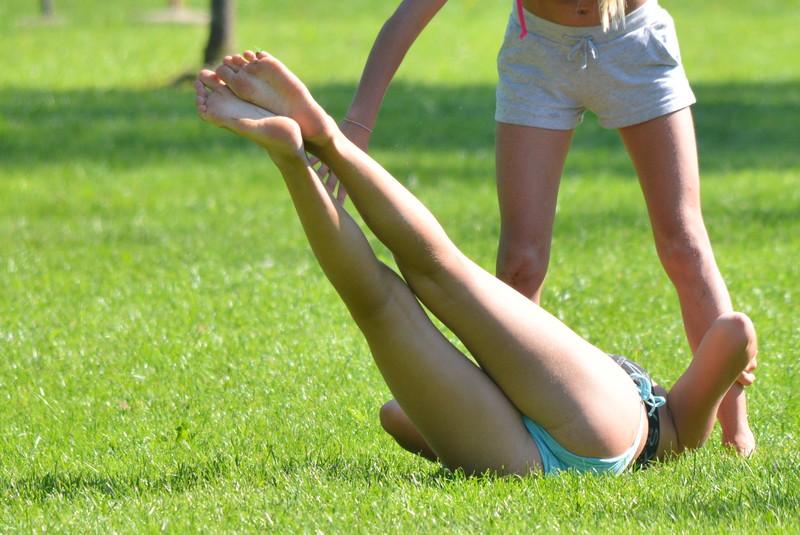 sand volleyball teens in bikinis & shorts