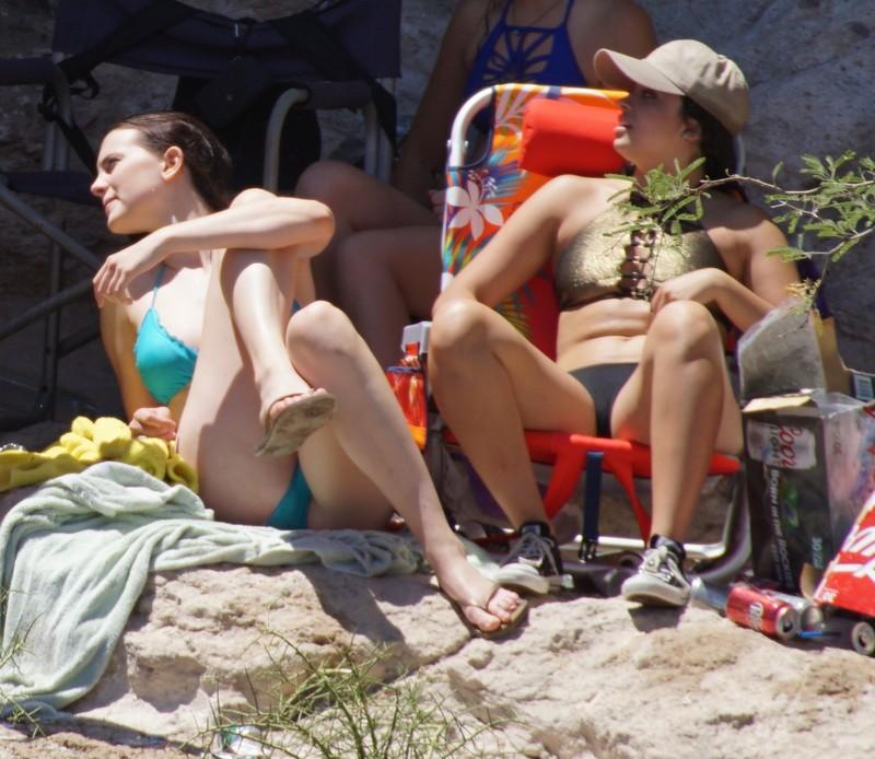 tourist girls in shorts & various swimwear