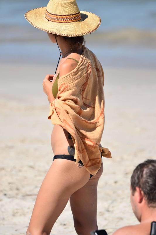 sexy tattooed lady in naughty bikini