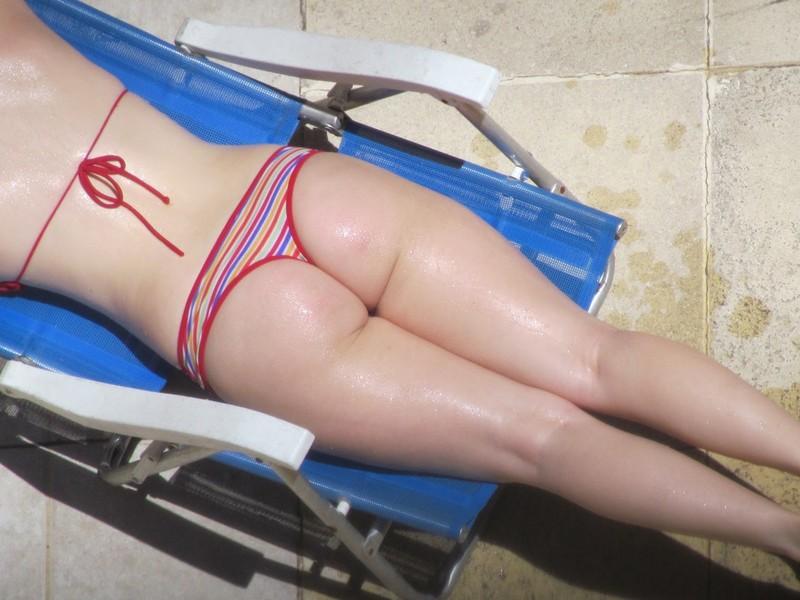 sunbathing babe in lovely bikini