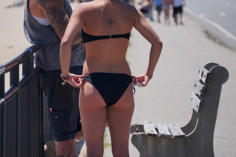handsome milf booty in a black bikini