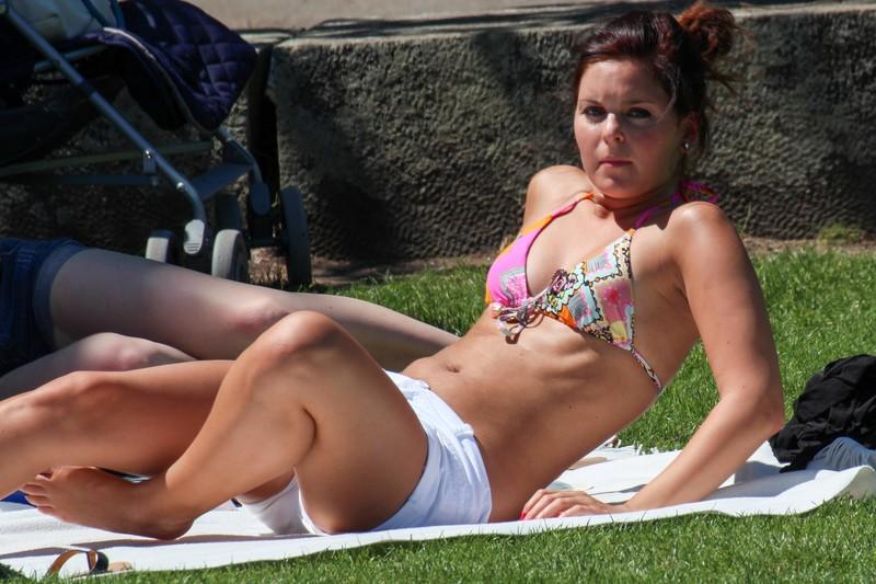 sunbather lady in bikini top & white shorts
