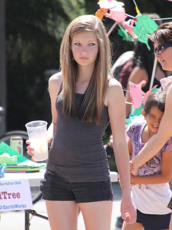 blonde coed teen in black shorts