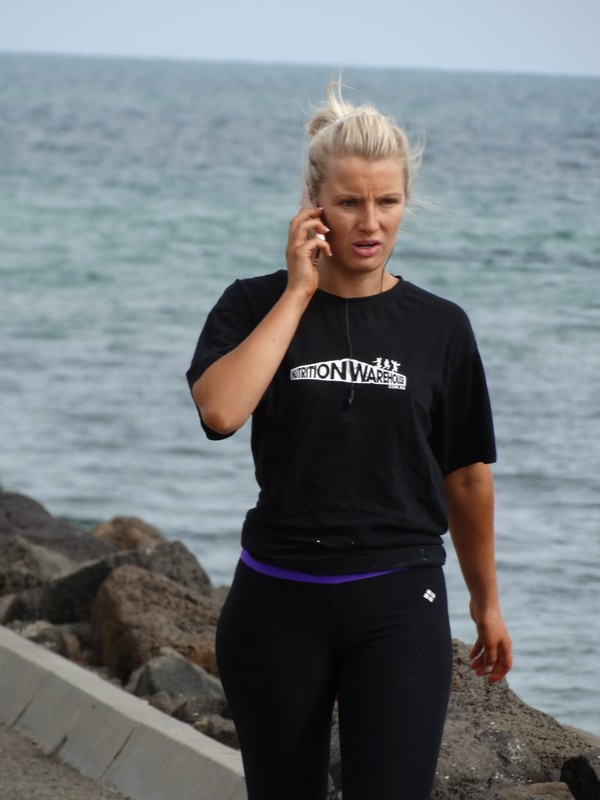 cute blonde jogger lady on the pier