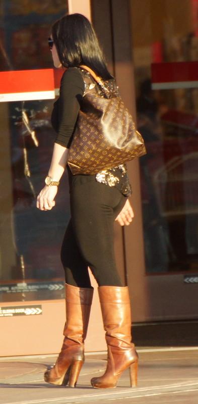 brunette milf in leggings & leather boots