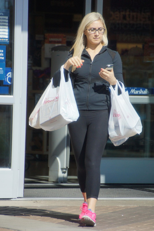 sexy blonde lady in black yogapants