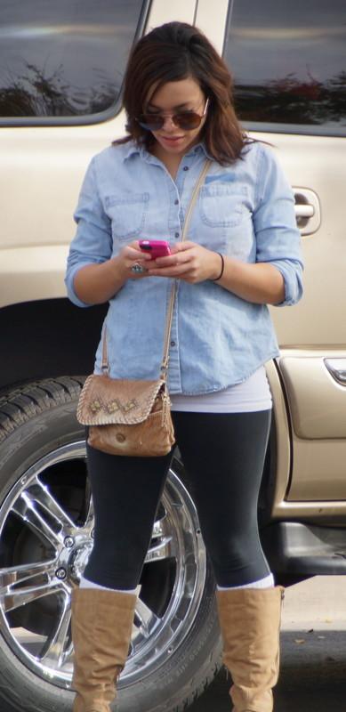 cute lady in boots & black lycra pants
