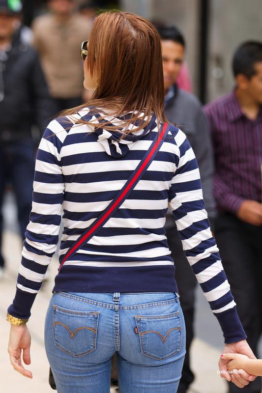 stylish latina milf in blue jeans