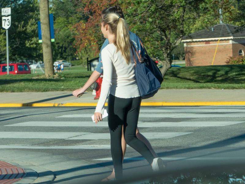 blonde college teen in tight black pants