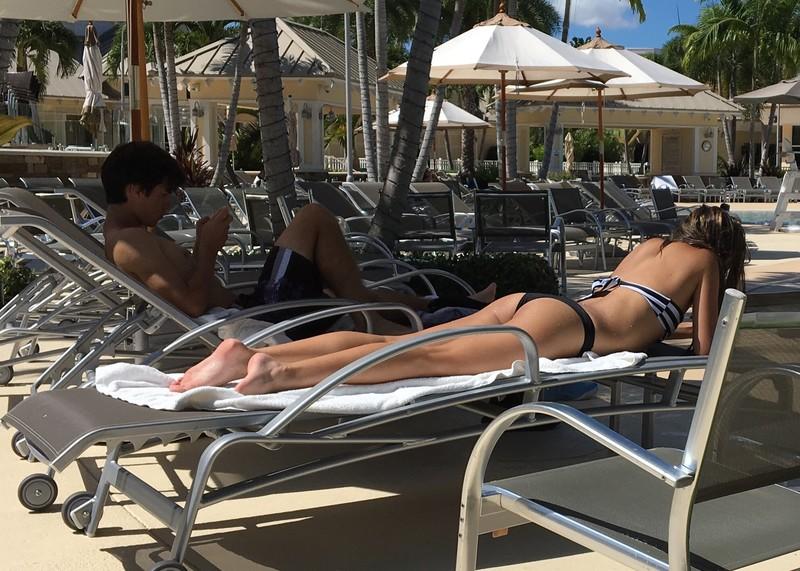 hotel pool tanning booty in sexy bikini