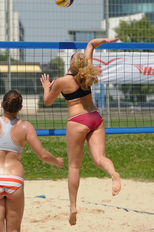 beach volleyball blonde chick in black & red bikini