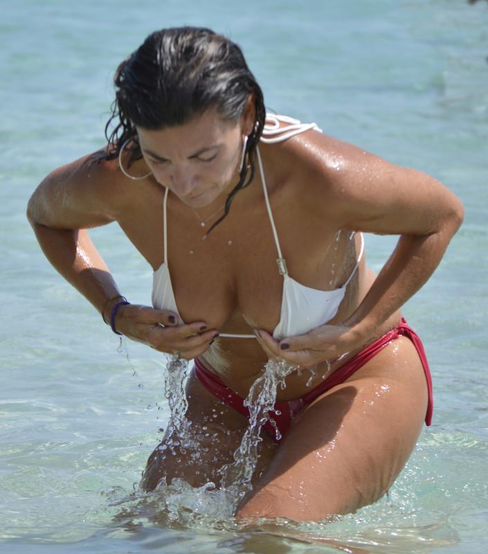 sexy latina milf in wet bikini at beach