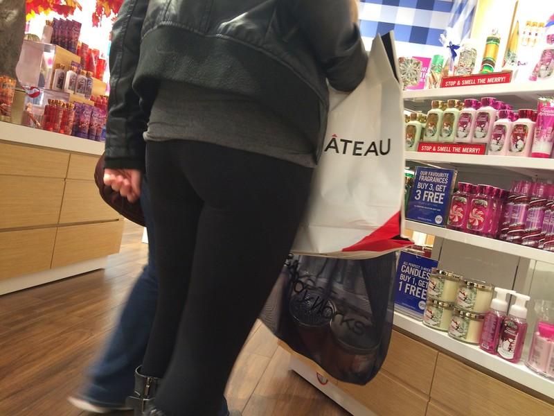 beautiful shopper lady in black leggings