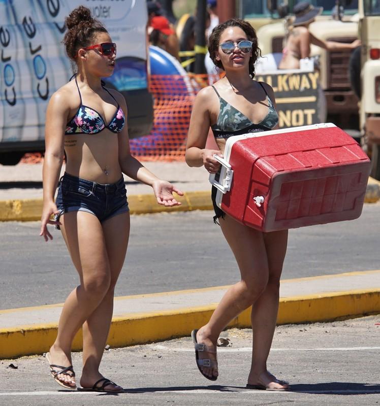 water tubing teens in bikinis & shorts