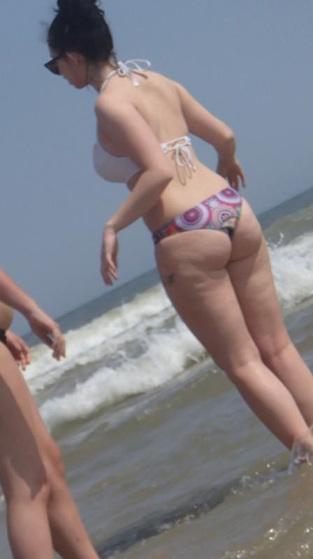 cheeky brunette in bathing suit