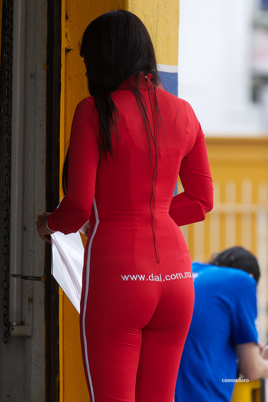 beautiful mexican promo girl in sexy catsuit
