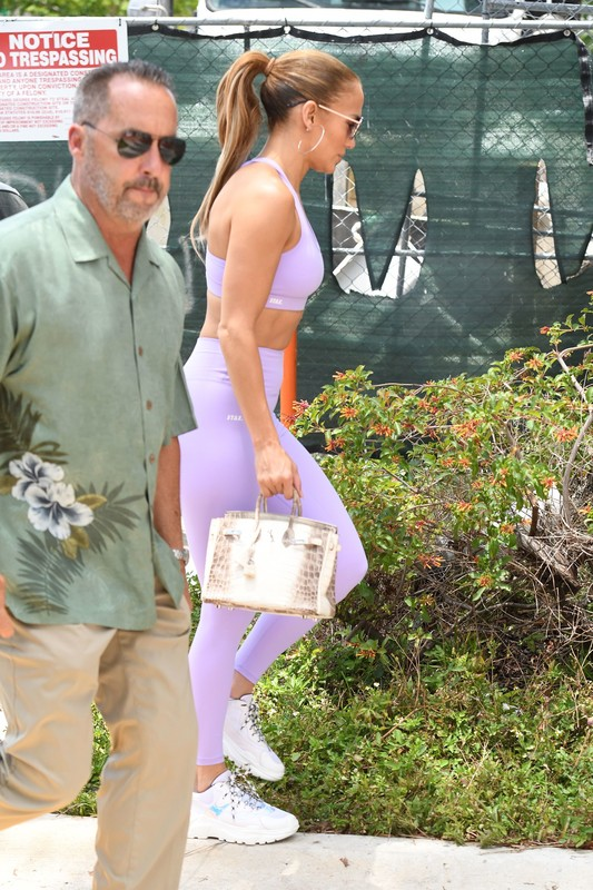 attractive milf Jennifer Lopez in purple gym outfit
