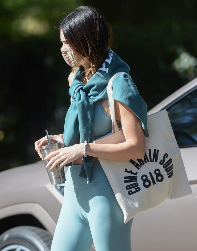 sexy babe Kendall Jenner in green lycra sportswear