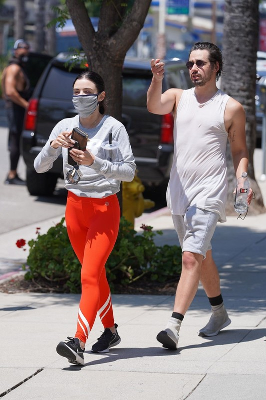 sexy milf Lucy Hale in red yogapants