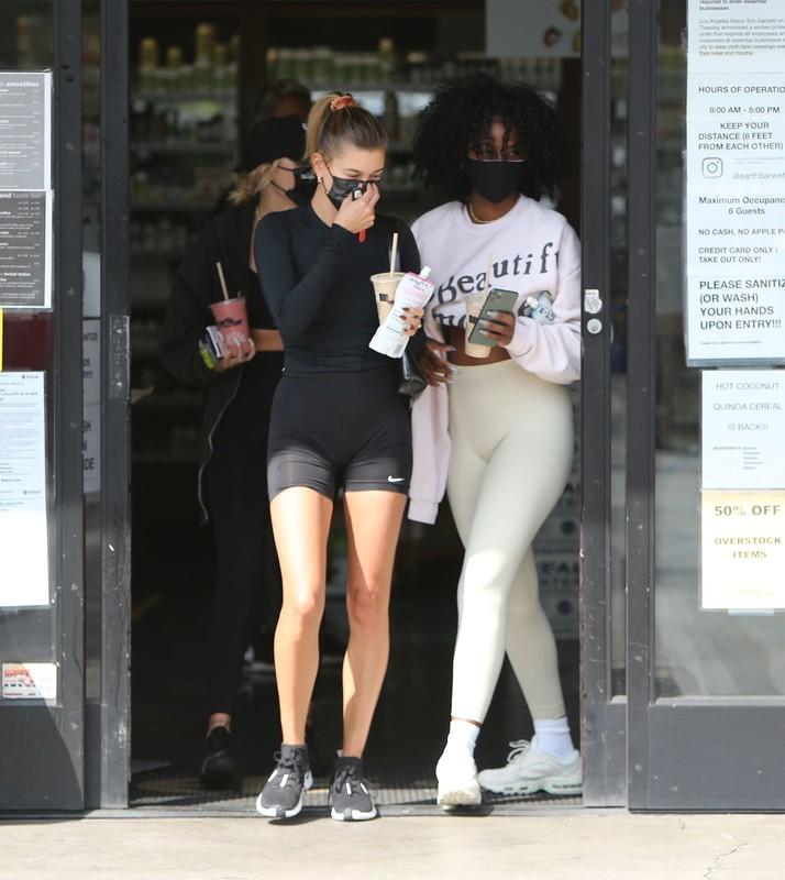 beautiful lady Hailey Bieber in black nike yoga shorts