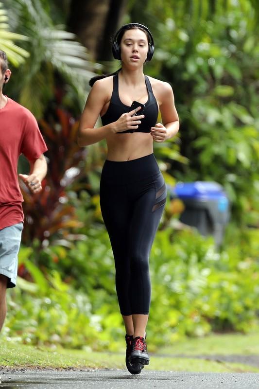 sexy jogger lady Alexis Ren in black tight gym uniform