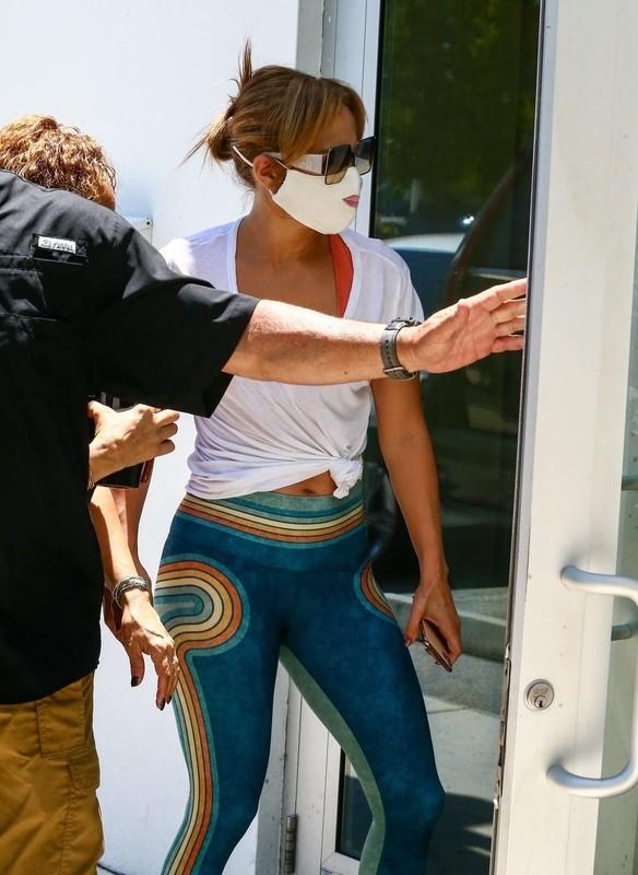 attractive babe Jennifer Lopez in tight lycra pants