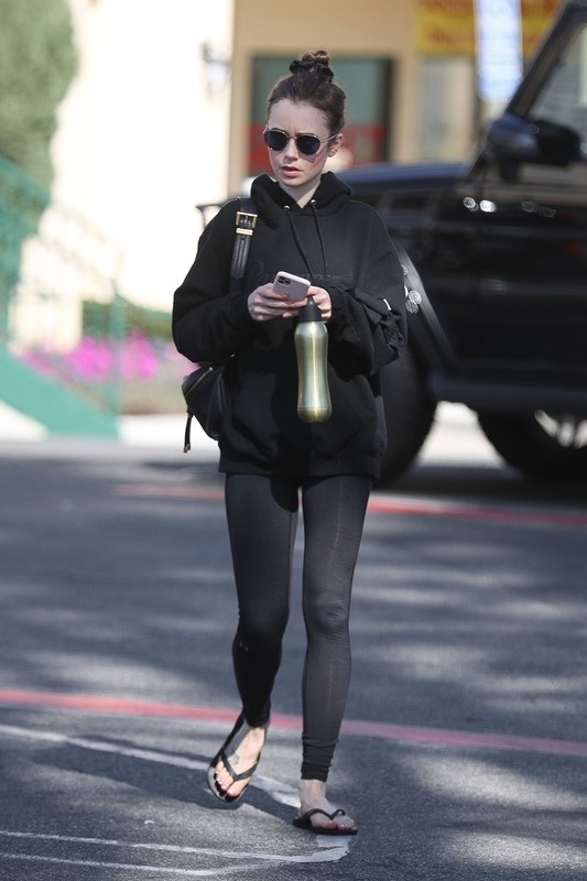 sweet milf Lily Collins in tight yoga pants