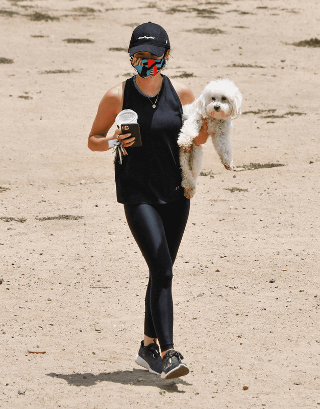 hiker chick Lucy Hale in shiny black leggings