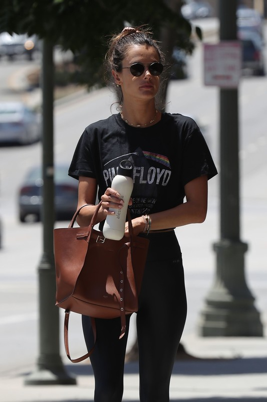 handsome lady Alessandra Ambrosio in black shiny leggings